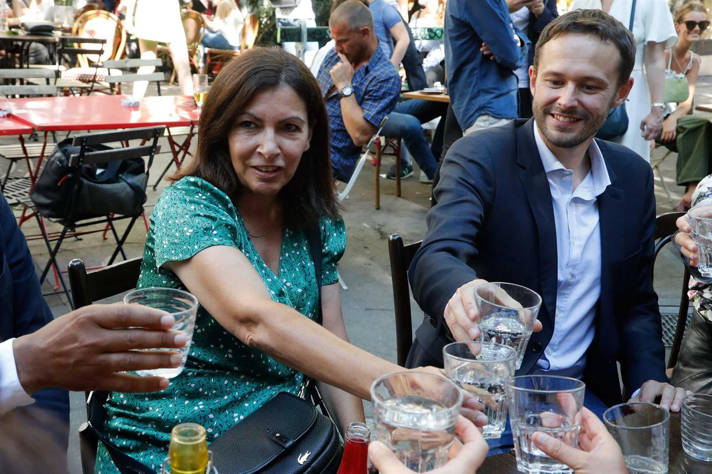 Socialist Anne Hidalgo, current mayor of Paris, toasts with David Belliard, of the Greens