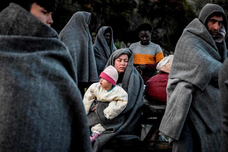 Migrantes e refugiados da Turquia na ilha grega de Lesbos
