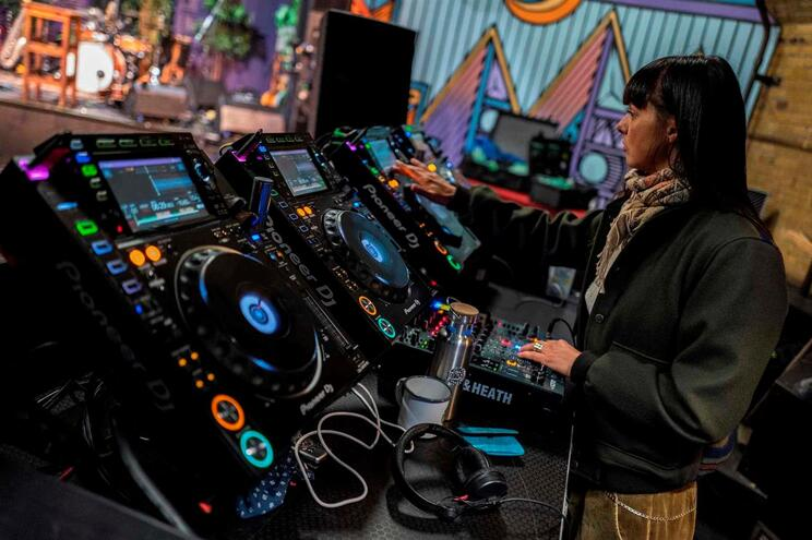 DJ Mira prepares her console at the Kater Blau club in Berlin on March 20, 2020, prior to a live-streamed