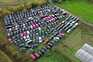An aerial view shows black London taxi cabs parked up in a field in Epping, north-east of London on November