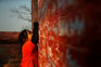 A child writes on the wall of a Saraswati temple during the Shreepanchami festival dedicated to goddess