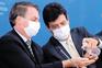 Jair Bolsonaro e o ministro da Saúde brasileiro, Luiz Henrique Mandetta
