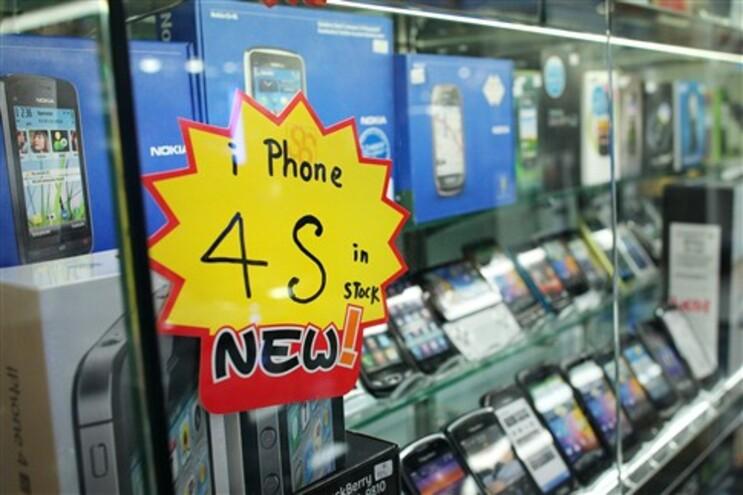 Anúncio da venda do novo iPhone em Hong Kong