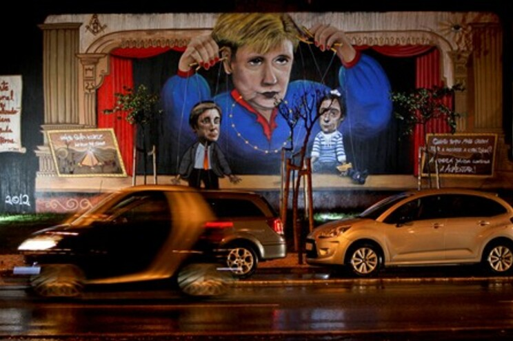 Mural em Lisboa representa Merkel a manusear Passos Coelho e Portas