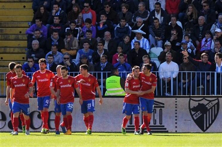 Hélder Postiga, à direita, festeja com os companheiros de equipa