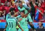 epa05383996 Cristiano Ronaldo of Portugal (R) celebrates after scoring the 2-2 goal during the UEFA EURO