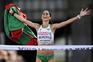 epa05418141 Sara Moreira from Portugal celebrates winning the Women's Half Marathon at the European Athletics