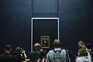 epa09211383 Visitors wearing protective face masks line up to see Leonardo da Vinci's painting La Gioconda