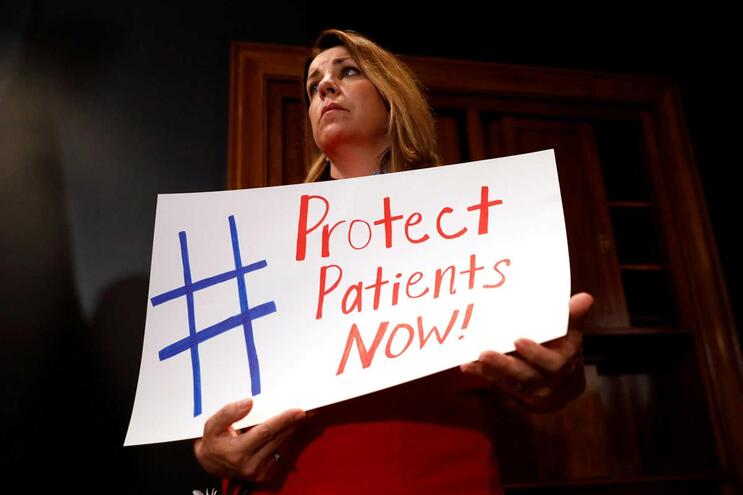 """Cartaz de apoio ao programa """"Obamacare"""""""