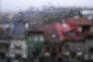 Domingo cinzento e chuvoso mas com subida de temperatura