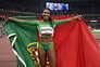 Patrícia Mamona com a bandeira de Portugal depois de ter saltado 15,01 metros