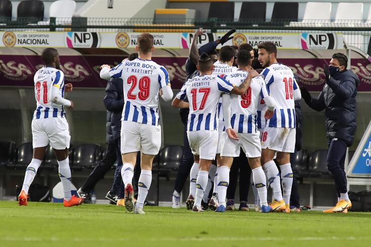 epa08933550 FC Porto players celebrate after scoring a goal against Nacional during their Portuguese