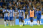 FC Porto's players react after loosing 2-3 during their UEFA Champions League third qualifying round