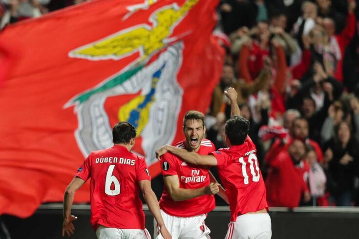 Benfica's Francisco Ferro (C) celebrates with his teammates Ruben Dias (L) and Jonas (D) after scoring