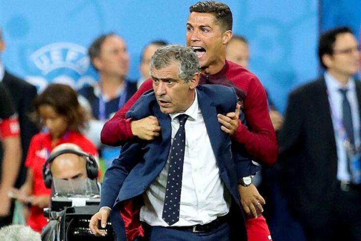 Portugal Cristiano Ronaldo celebrates with the head coach Fernando Santos in the end of the UEFA EURO