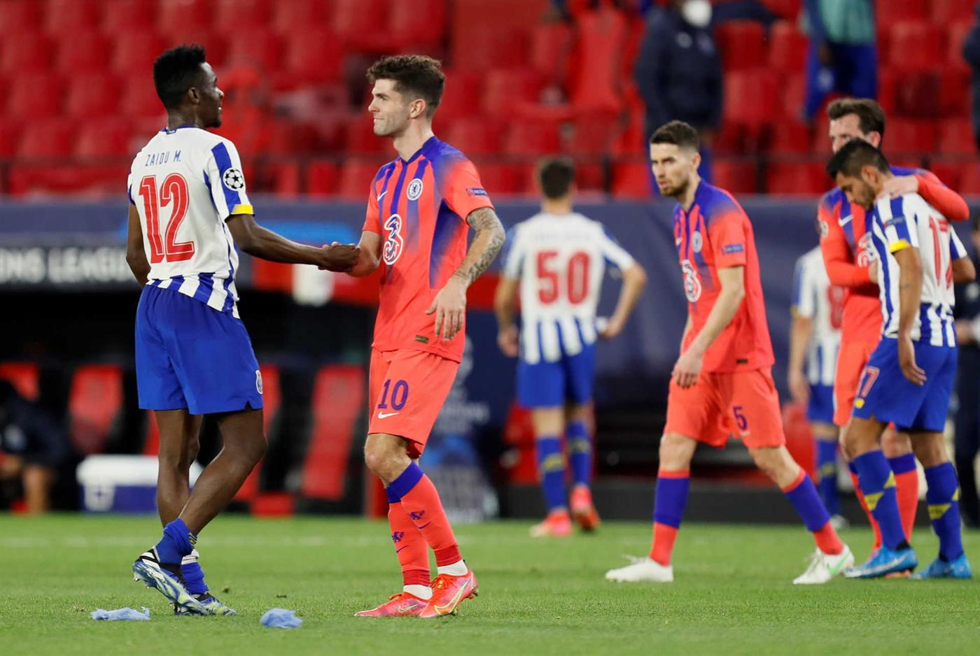 epa09121407 Porto's defender Zaidu Sanusi (L) greets Chelsea's winger Christian Pulisic (2-L) after the