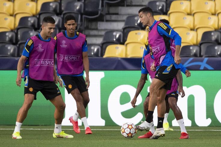 Diogo Dalot e Cristiano Ronaldo em treino do Manchester United