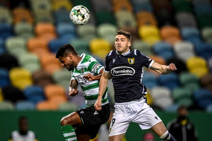 Sporting's Brazilian defender Marcelo Ferreira (L) heads the ball with Famalicao's Portuguese defender
