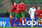 Portugal's right back Diogo Dalot (2L) and Portugal's center forward Dany Mota (3L) celebrate after scoring