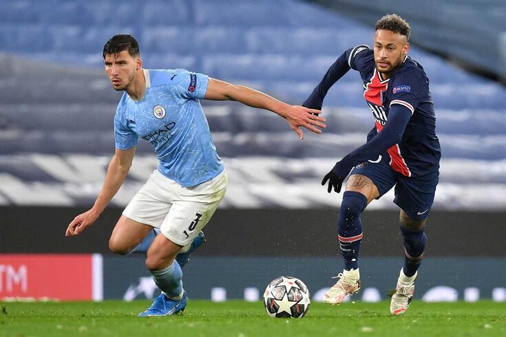 Manchester City's Portuguese defender Ruben Dias (L) vies with Paris Saint-Germain's Brazilian forward