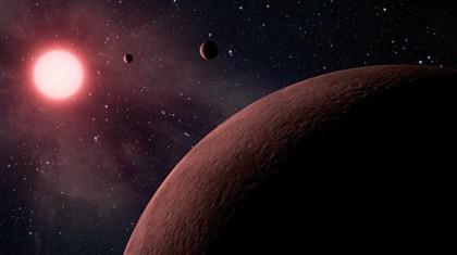 Representação artística dos três planetas e da sua estrela