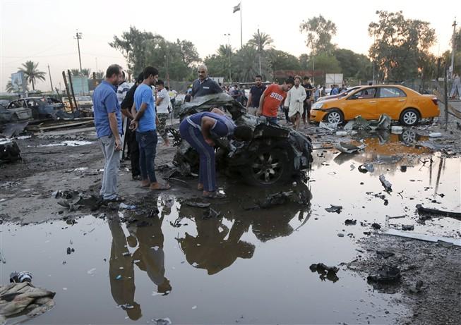Explosão de bomba num carro faz 11 mortos no Iraque Ng4559871